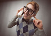 Nerd student with an old mobile phone — Stock Photo