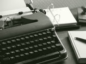 Old typewriter on a wooden desk — Stock Photo