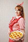 Beautiful woman holding italian pie. — Stock Photo