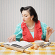 Girl reads a cookbook — Stock Photo
