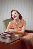 Young woman listening to music from a turntable — Stock Photo