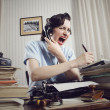 Woman shouting into telephone - Stock Photo
