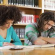 Students at library — Stock Photo