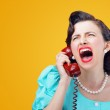 Angry woman screaming on the phone — Stock Photo