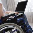 Disabled young woman using laptop — Stock Photo #25864865