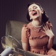 Woman cooling herself with fan — Stock Photo