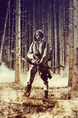 A male bow hunter wearing gas mask — Stock Photo