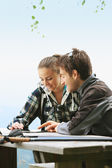 Couple using tablet on the mountain — Stock Photo