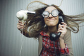 Nerdy woman drying hair — Stock Photo