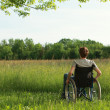 Disabled young man on the park — Stock Photo