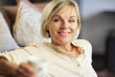 Portrait of senior woman having a cup of coffee — Stock Photo