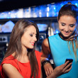 Two women enjoying with a smartphone — Stockfoto