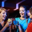 Young female friends celebrating in a nightclub  — Stok fotoğraf