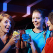 Young female friends celebrating in a nightclub  — Stock Photo