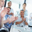 Business people clapping in a meeting — Stock Photo