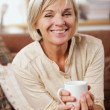 Portrait of senior woman having a cup of coffee — Stock Photo #34996629