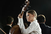 A cellist in concert — Stock Photo