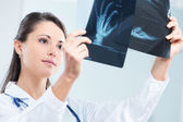 Female doctor examing an x-ray — Stock Photo