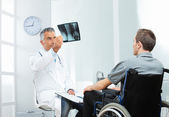 Disabled young man at doctor office — Stock Photo