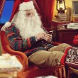 Santa Claus and smartphone — Stock Photo