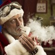 Bad Santa smoking a joint — Stock Photo