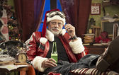 Bad Santa smoking a cigarette — Stock Photo