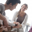 Romantic boy playing guitar for her girlfriend — Stockfoto