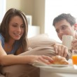 Couple having breakfast in bed — Stock Photo