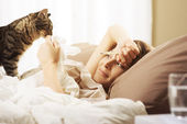 Woman lying sick in bed — Stock Photo