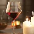 Red wine with candles — Stock Photo