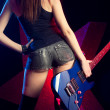 Rock star girl with guitar — Stock Photo
