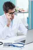 Doctor working at his desk — Stock Photo