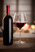 Wineglass and bottle still life — Stock Photo