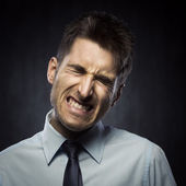 Angry young businessman — Stock Photo