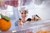 Happy woman holding pastry — Stock Photo