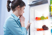 Looking in the refrigerator — Stock Photo
