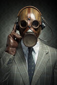 Vintage gas mask and headphones — Stock fotografie