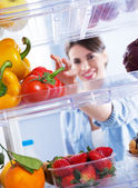 Healthy food in the refrigerator — Stock Photo
