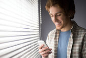 Text messaging on smartphone — Stock Photo
