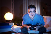 Playing videogames late at night — Stock Photo