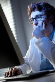 Researcher working at computer — Stockfoto