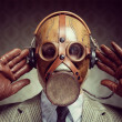 Vintage gas mask and headphones — Stock Photo