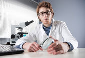 Young researcher with magnifier — Stock Photo