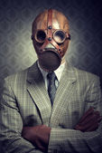 Vintage businessman wearing gas mask — Stockfoto