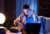 Businessman working overtime at home — Stock Photo
