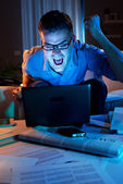 Angry businessman working at home until late — Stock Photo