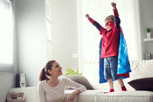 Little superhero with his mother — Stock Photo