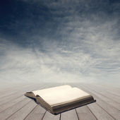 Knowledge concept with open book — Stock Photo