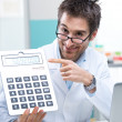Doctor and calculator — Stock Photo #45689149
