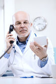 Doctor on the phone — Stock Photo
